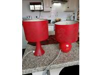 Pair of red lamps.