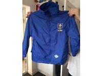"Reversible blue coat with ""Colmore Junior School"" logo. Big enough for Junior School £10"