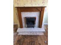 Gas fire with marble hearth and wood surround