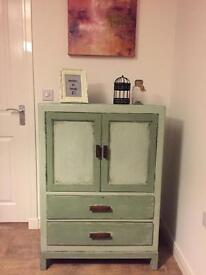 A lovely upcycled retro style cupboard, chest of drawers in chalk light/lime green finish