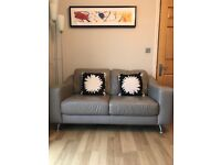 Leather swivel chair, footstool and 2 seater sofa