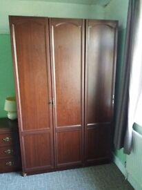 Mahogany effect triple wardrobe and chest of drawers. )