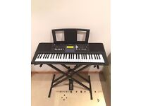 Yamaha PSR-E333 portable electric 61-key touch response keyboard with stand, pedal and free books