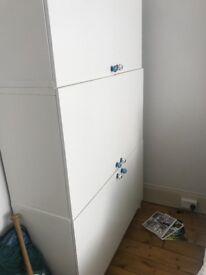 Ikea modular white storage with movable shelves inside
