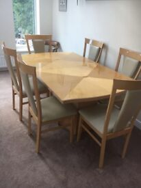 Harvey's Extendable dinning table and 6 chairs WITH matching dresser AND glass display cabinet