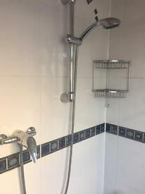 Used but cared for Chrome shower head with hose, slider rising rail & fixings
