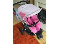 Girls pink quinny pram for sale