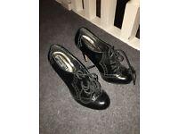 Black stiletto ankle boots