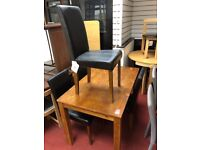 Pine table and 4 faux leather chairs