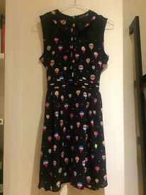 SELL NEVER WORN little black dress with balloons pattern, size 6