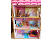Doll house with wooden furniture by Kid Kraft
