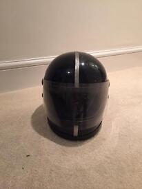 Retro black motorcycle helmet with silver stripe