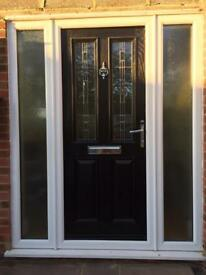 Front door with side glass panels