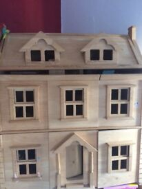Dolls house and furniture . Lovely dolls house with plenty of furniture to get your child started.
