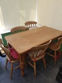 Pine farmhouse table and chairs, good condition space required.