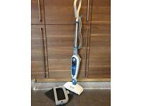 Black & Decker Steam-mop ( FSM1600) with resting mat, carpet glider and one cloth pad.