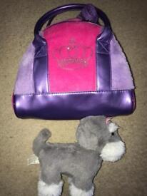 Puppy dog in a handbag carry bag
