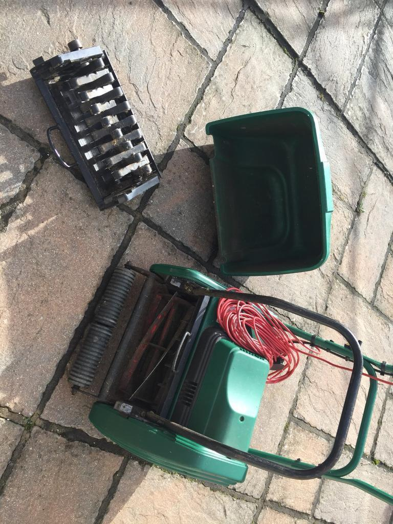 Electric lawnmower with scarifier