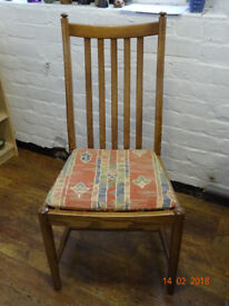 Four hand-crafted Ercol dining chairs in oak