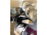Two sets of golf clubs in bags