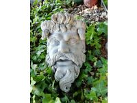 Impressive heavy solid stone head of Neptune for hanging on a garden wall.