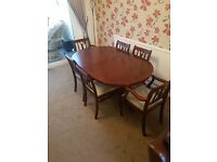 Large extendable vaneer table and six matching chairs plus side cabinet.