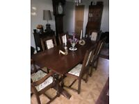 Solid oak Old Charm Dining Table and six chairs in good solid condition