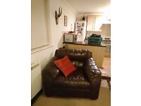 2 large brown leather chairs