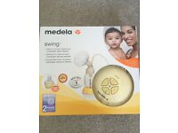 Medela Swing breast pump. AS NEW CONDITION. Medela bottle and all attachments included.