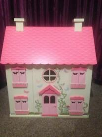 Beautiful pink wooden dolls house in excellent condition with furniture and dolls