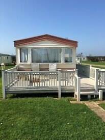 Absolute BARGAIN Caravan.... for sale. Double glazed central heating and full wrap around deck