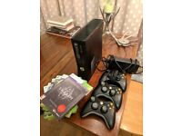 Xbox360 S with 3 controller and 6 games.