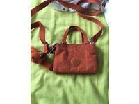 Orange Kipling mini handbag