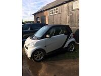 2008 smart car in white