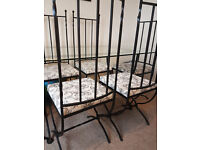 QUALITY 6 SEAT GLASS DINING TABLE WITH WROUGHT IRON CHAIRS £150.00 ONO