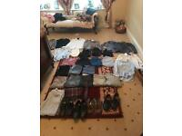 Men's size small + medium clothes. Already washed + ironed.