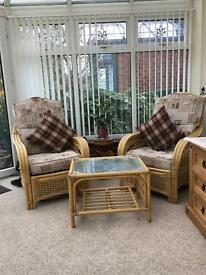 Wicker 2 seater and 2 chairs and glsss table