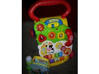 Vtech baby walker my first steps plays melodies and flash lights comes with vtech interactive book