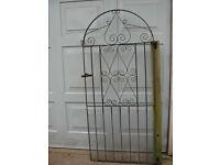 Decorative heavy wrought iron garden gate