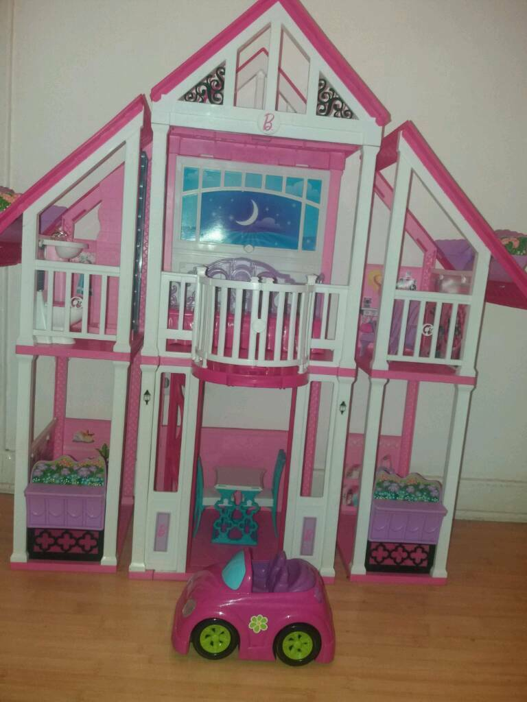 Barbie California dream house and small car. Some furniture missing hence price. Pick up only.