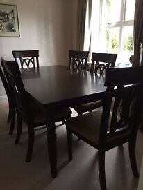 For Sale: Extendable (up to 10) Dark wood effect Dining room table & 6 upholstered chairs