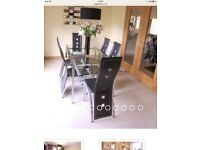 Ikea dining room glass table and black chairs