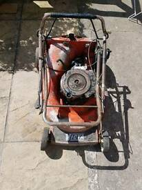 Petrol lawn mower with spares