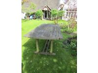 Heavy garden table and two chairs, wood distorted, handman could fix. Free, you take away