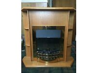 Freestanding electric fire and surround with real coal and flame effect