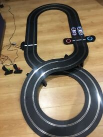 Scalextrics set and two cars