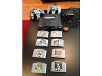 Nintendo 64 + 2 controllers +8games