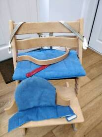 Tripp Trapp chair with baby accessories