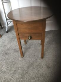 Victorian wooden sewing table with upholstered interior and drawer. 16 inch diameter x 20 inch high