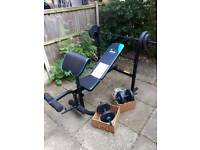 Un-used weight bench with weights